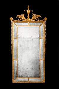 Mirror wall hanging formal vintage antique with original glass isolated on black