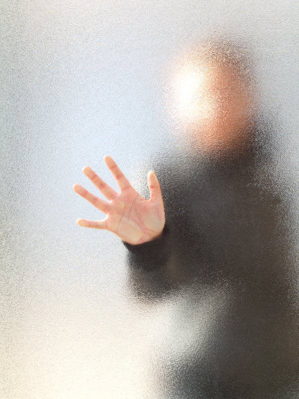 Silhouette of a girl through frosted glass
